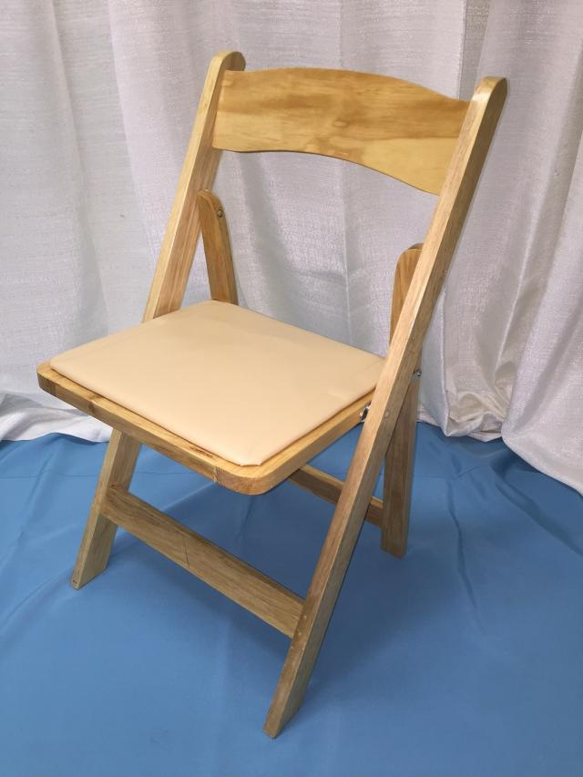 Where to find Chair, Natural folding w tan pad in Lansing